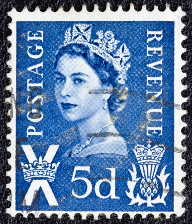 UNITED KINGDOM - CIRCA 1958: A postage stamp printed in Scotland shows a portrait of queen Elizabeth II, circa 1958. Stock Photo - 13789952