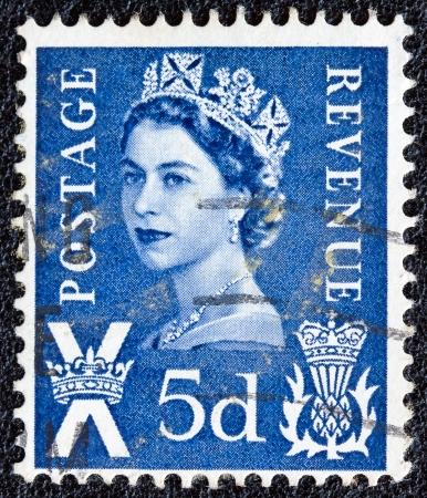 UNITED KINGDOM - CIRCA 1958: A postage stamp printed in Scotland shows a portrait of queen Elizabeth II, circa 1958. Stock Photo - 13789952
