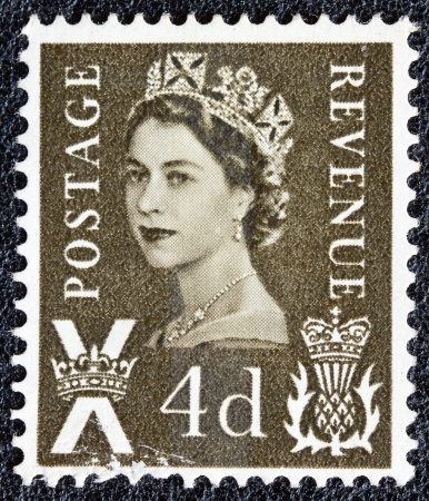 UNITED KINGDOM - CIRCA 1958: A postage stamp printed in Scotland shows a portrait of queen Elizabeth II, circa 1958.