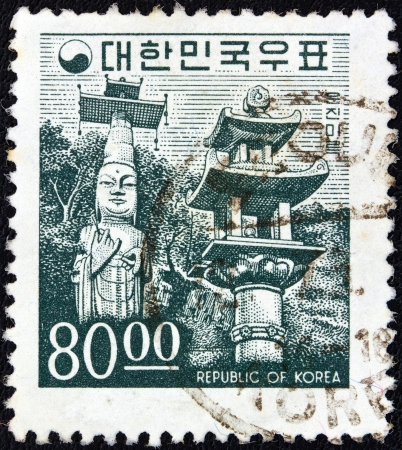 SOUTH KOREA - CIRCA 1966: A stamp printed in South Korea shows Unjinmiruk Buddha statue, Kwanchok Temple, circa 1966.