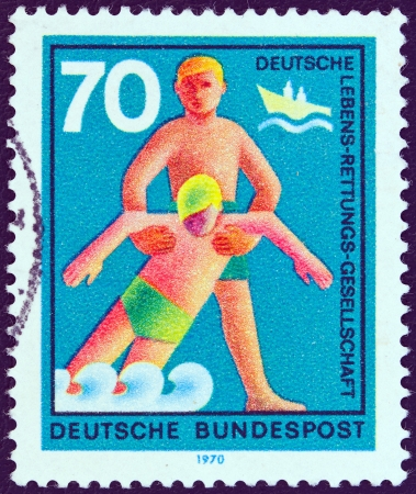 bundes: GERMANY - CIRCA 1970: A stamp printed in Germany from the Voluntary Relief Services issue shows Rescue from drowning, circa 1970.  Editorial
