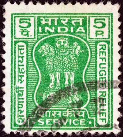 ashoka: INDIA - CIRCA 1971: A stamp printed in India shows four Indian lions capital of Ashoka Pillar (refugee relief issue), circa 1971.