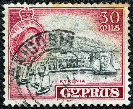 CYPRUS - CIRCA 1960: A stamp printed in Cyprus, when the island was still under British occupation, shows a portrait of Queen Elizabeth II and the port of Kyrenia, circa 1960.