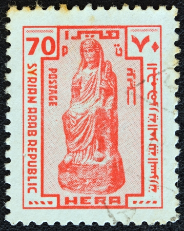 stempeln: SYRIA - CIRCA 1976: A stamp printed in Syria shows an ancient Statue of Hera, circa 1976. Editorial