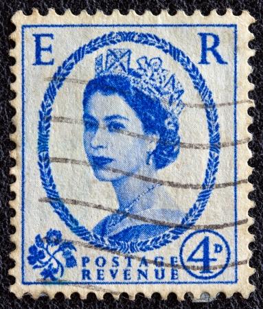 UNITED KINGDOM - CIRCA 1952: A postage stamp printed in United Kingdom shows a portrait of queen Elizabeth II, circa 1952.
