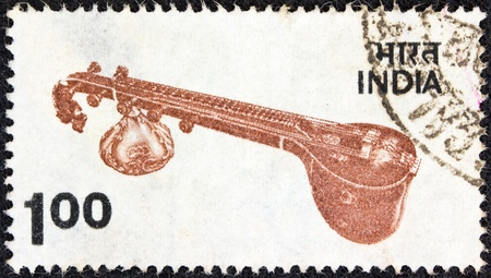 indian postal stamp: INDIA - CIRCA 1974: A stamp printed in India shows a sitar traditional instrument, circa 1974.
