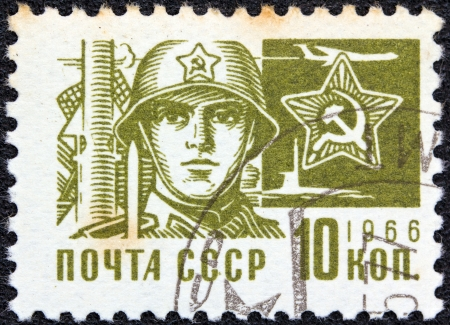 USSR - CIRCA 1966: A stamp printed in USSR from the Society and Technology issue shows a soldier and star emblem, circa 1966.