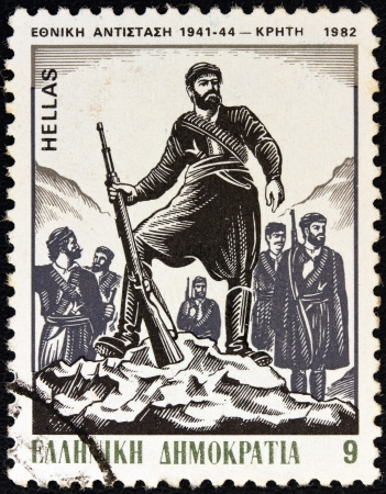 onset: GREECE - CIRCA 1982: A stamp printed in Greece from the National Resistance, 1941-44 issue shows the Onset of the Struggle in Crete (P. Gravalos), circa 1982.