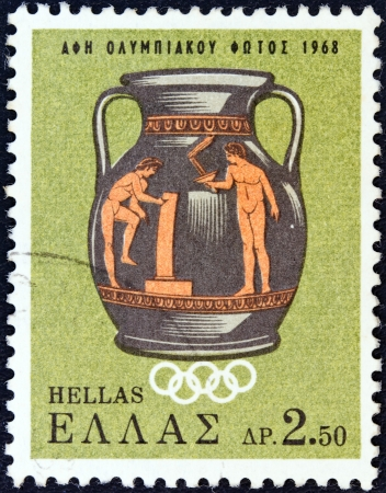GREECE - CIRCA 1968: A stamp printed in Greece issued for the lighting of the Olympic Flame for the 1968 summer Olympics of Mexico shows an Olympic scene on Attic vase, circa 1968.