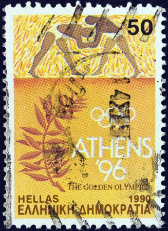 GREECE - CIRCA 1990: A stamp printed in Greece issued for Athens candidacy of 1996 summer Olympic games shows wrestlers and olive branch, circa 1990.