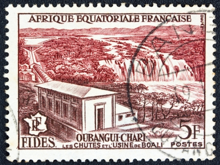 FRENCH EQUATORIAL AFRICA - CIRCA 1956: A stamp printed in France shows Boali waterfall and power station, circa 1956.