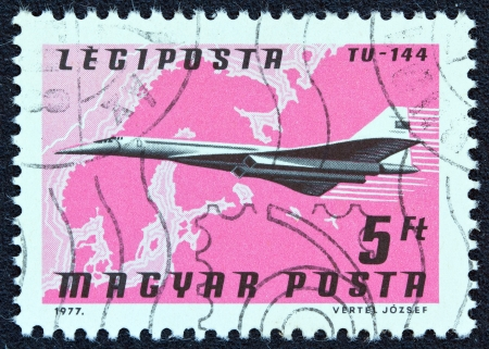 magyar posta: HUNGARY - CIRCA 1977: A stamp printed in Hungary from the Planes, Airlines and Maps issue shows a Tupolev TU-144, Aeroflot and Northern Europe map, circa 1977.