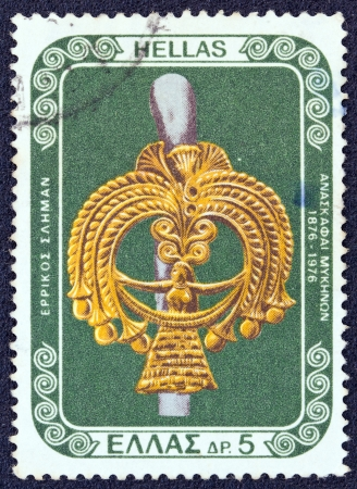 GREECE - CIRCA 1976: A stamp printed in Greece from the 100 years from Mycenae excavations issue shows a gold goddess head from a silver pin, circa 1976.