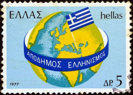 GREECE - CIRCA 1977: A stamp printed in Greece from the Greeks Abroad issue shows Globe and Greek flag, circa 1977.