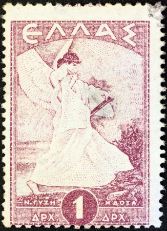 GREECE - CIRCA 1945: A stamp printed in Greece shows allegorical figure of Glory of Psara by Nikolaos Gyzis, circa 1945.