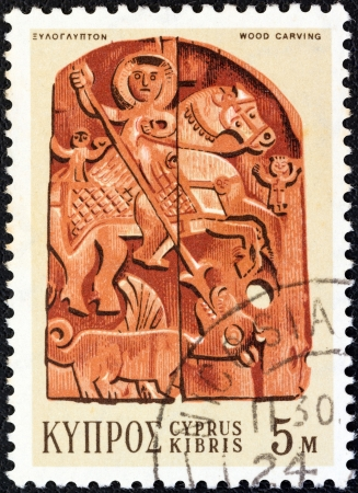 kypros: CYPRUS - CIRCA 1971: A stamp printed in Cyprus shows a wood carving of Saint George and Dragon (19th century bass-relief), circa 1971.