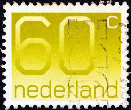 orange nassau: NETHERLANDS - CIRCA 1976: A stamp printed in the Netherlands shows numeral ordinary gum, circa 1976. Editorial