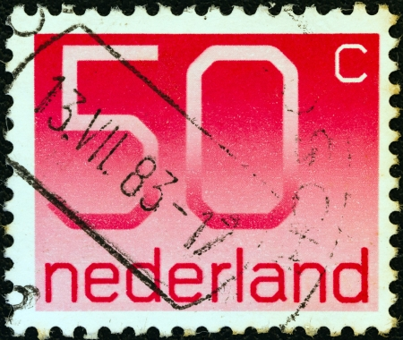 nederlan: NETHERLANDS - CIRCA 1976: A stamp printed in the Netherlands shows numeral ordinary gum, circa 1976. Editorial