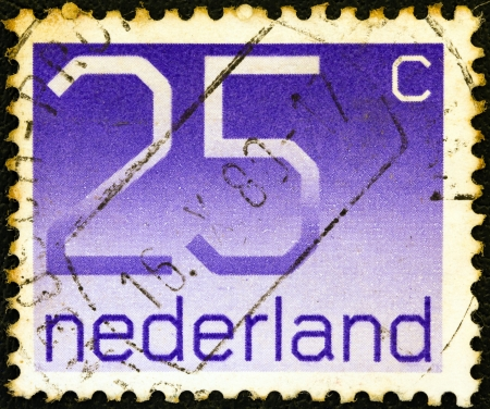 NETHERLANDS - CIRCA 1976: A stamp printed in the Netherlands shows numeral ordinary gum, circa 1976. Stock Photo - 14145539