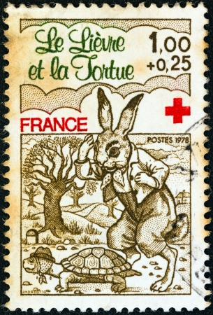 FRANCE - CIRCA 1978: A stamp printed in France from the Red Cross Fund. Fables of La Fontaine issue shows The Hare and the Tortoise, circa 1978.