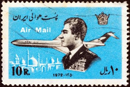 IRAN - CIRCA 1972: A stamp printed in Iran shows Mohammad Reza Shah Pahlavi and airplane, circa 1972. Stock Photo - 14142781