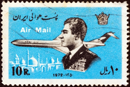 mohammad: IRAN - CIRCA 1972: A stamp printed in Iran shows Mohammad Reza Shah Pahlavi and airplane, circa 1972.