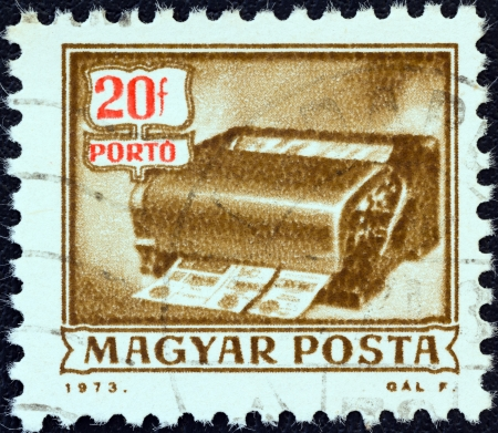 magyar: HUNGARY - CIRCA 1973: A stamp printed in Hungary from the Postal Operations issue shows a money-order cancelling machine, circa 1973.  Editorial
