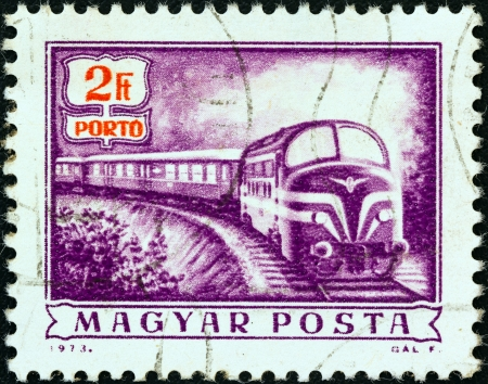 magyar posta: HUNGARY - CIRCA 1973: A stamp printed in Hungary from the Postal Operations issue shows a Diesel mail train, circa 1973.  Editorial