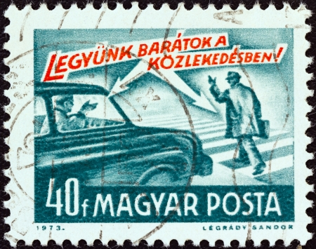 magyar posta: HUNGARY - CIRCA 1973: A stamp printed in Hungary from the Road Safety issue shows car and pedestrian and lets be friends ! inscription, circa 1973.