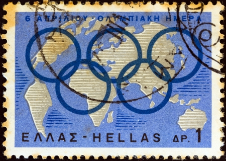 GREECE - CIRCA 1967: A stamp printed in Greece issued for 6th April, Olympic day shows Olympic Rings and globe, circa 1967.