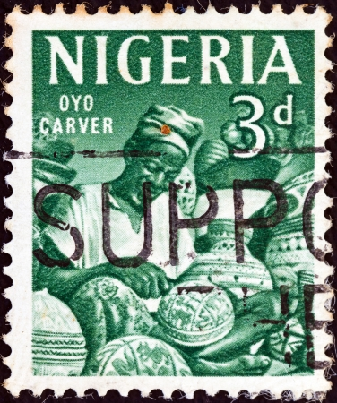 carver: NIGERIA - CIRCA 1961: A stamp printed in Nigeria shows Oyo carver, circa 1961.