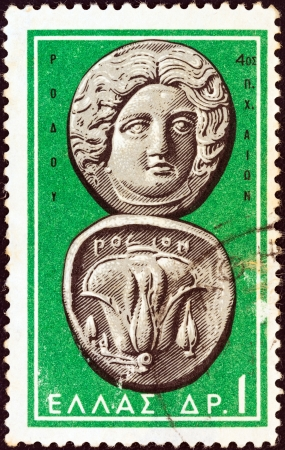 greek coins: GREECE - CIRCA 1963: A stamp printed in Greece from the Ancient Greek Coins issue shows a coin from Rhodes 4th century B.C. (Helios and rose), circa 1963.  Editorial
