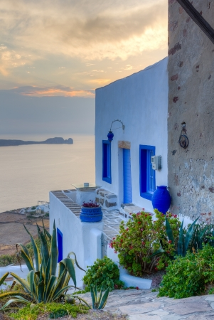 Beautiful traditional house at sunset, Plaka village, Milos island, Cyclades, Greece photo