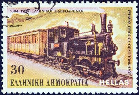 centenary: GREECE - CIRCA 1984: A stamp printed in Greece from the Railway Centenary issue shows Piraeus-Peloponnese steam train, circa 1984.  Editorial