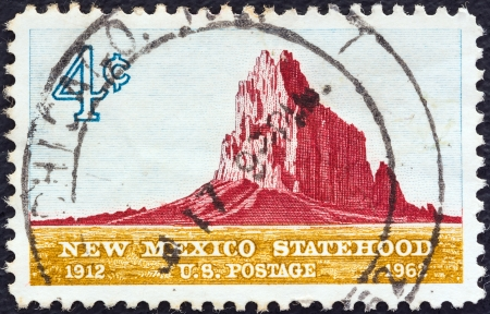 statehood: USA - CIRCA 1962: A stamp printed in USA issued for the 50th anniversary of Statehood of New Mexico shows Shiprock, New Mexico, circa 1962.  Editorial