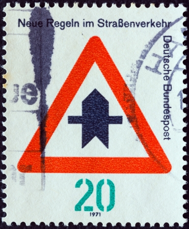 bundespost: GERMANY - CIRCA 1971: A stamp printed in Germany from the New Road Traffic Regulations (1st series) issue shows Right-of-way across junction, circa 1971.