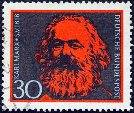 marx: GERMANY - CIRCA 1968: A stamp printed in Germany issued for the 150th birth anniversary of Karl Marx shows Karl Marx, circa 1968.