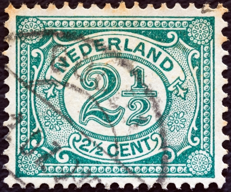 NETHERLANDS - CIRCA 1898: A stamp printed in the Netherlands shows it's value, circa 1898.  Stock Photo - 15740199