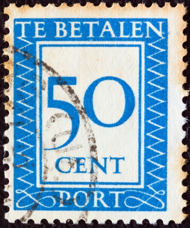 NETHERLANDS - CIRCA 1947: A stamp printed in the Netherlands shows it's value, circa 1947.  Stock Photo - 15740202