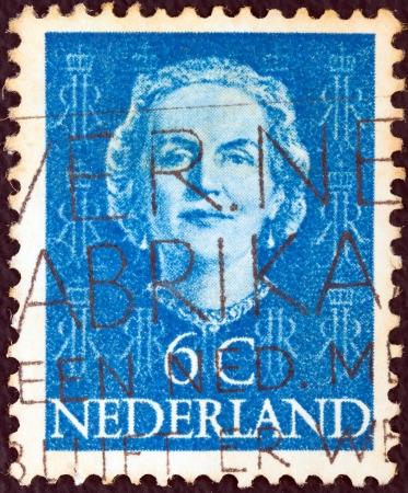 orange nassau: NETHERLANDS - CIRCA 1949: A stamp printed in the Netherlands shows Queen Juliana, circa 1949.