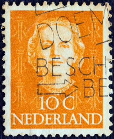 stempeln: NETHERLANDS - CIRCA 1949: A stamp printed in the Netherlands shows Queen Juliana, circa 1949.