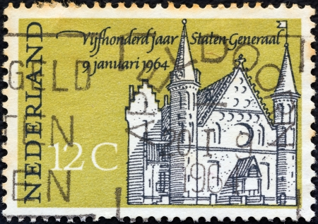 NETHERLANDS - CIRCA 1964: A stamp printed in the Netherlands issued for the 500th anniversary of 1st States-General Meeting shows Knights' Hall, The Hague, circa 1964.  Stock Photo - 15740197