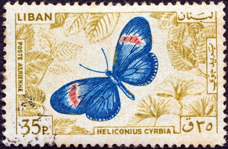 LEBANON - CIRCA 1965: A stamp printed in Lebanon from the  Butterflies issue shows a Small postman (Heliconius cyrbia), circa 1965.