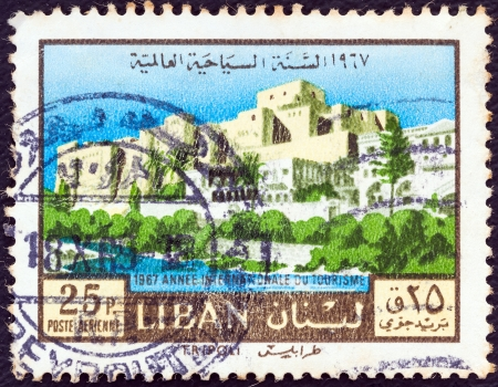 libani: LEBANON - CIRCA 1967: A stamp printed in Lebanon from the 1967 International year of tourism issue shows Tripoli city, circa 1967.