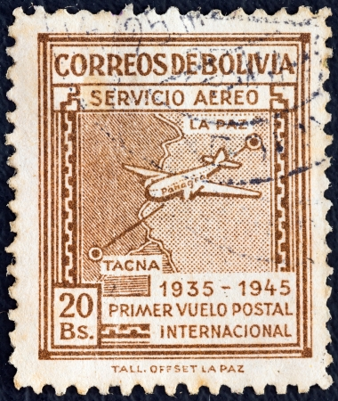 BOLIVIA - CIRCA 1945: A stamp printed in Bolivia from the Panagra Airways, 10th anniversary of First La Paz-Tacna Flight issue shows Douglas DC-2 and National Airways Route Map, circa 1945.