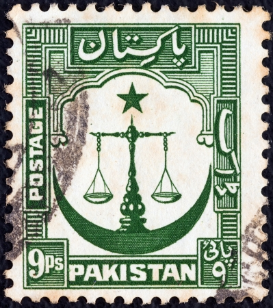 PAKISTAN - CIRCA 1948: A stamp printed in Pakistan shows Scales of Justice with crescent moon, circa 1948.  Stock Photo - 15876962
