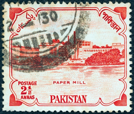 PAKISTAN - CIRCA 1955: A stamp printed in Pakistan issued for the 8th anniversary of Independence shows Karnaphuli Paper Mill, East Bengal, circa 1955.  Stock Photo - 15876964