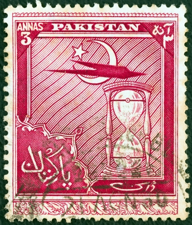 PAKISTAN - CIRCA 1951: A stamp printed in Pakistan issued for the 4th anniversary of Independence shows airplane and hourglass, circa 1951.