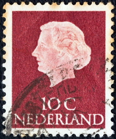 NETHERLANDS - CIRCA 1953: A stamp printed in the Netherlands shows Queen Juliana, circa 1953.  Stock Photo - 15876963