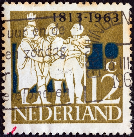 stempeln: NETHERLANDS - CIRCA 1963: A stamp printed in the Netherlands from the 150th anniversary of Kingdom of the Netherlands issue shows the Driemanschap (Triumvirate) of 1813, circa 1963.  Editorial